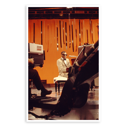 Ray Charles in front of TV studio cameras
