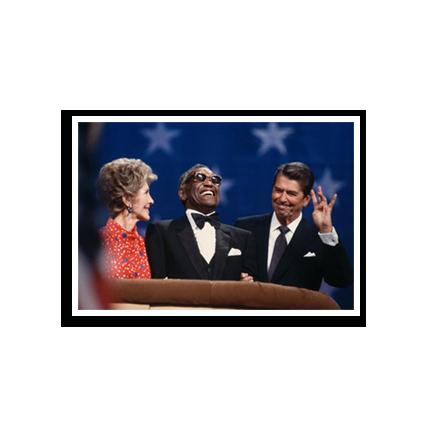 Nancy Reagan, Ray Charles and Ronald Reagan standing at a podium