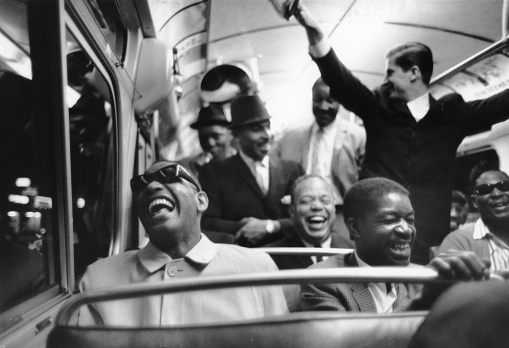 Ray Charles on a bus and laughing