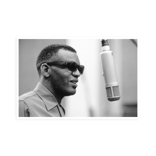 Ray Charles standing in front of a microphone