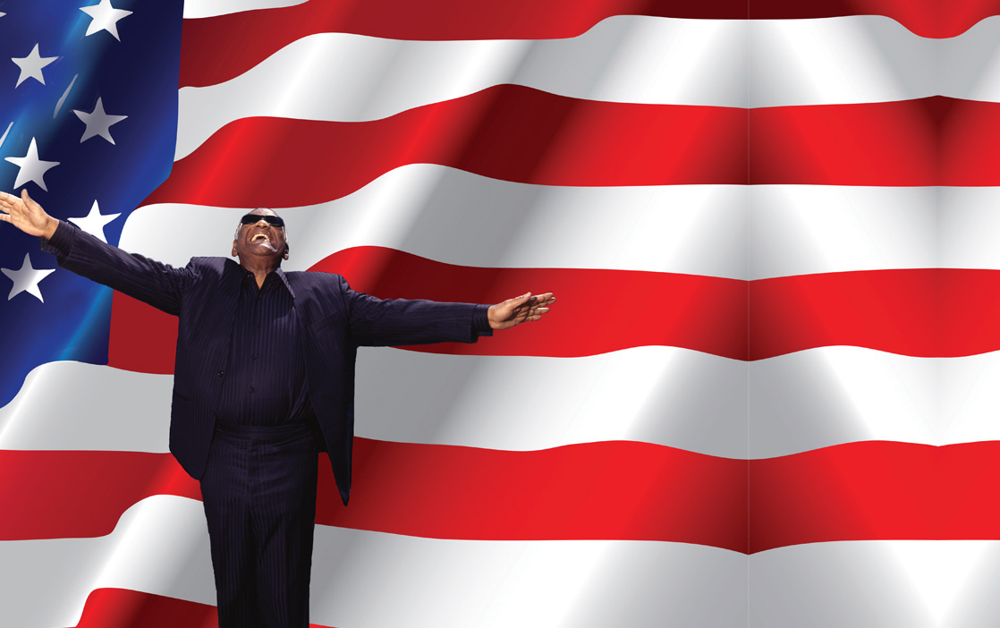 Ray Charles standing in front of the American flag