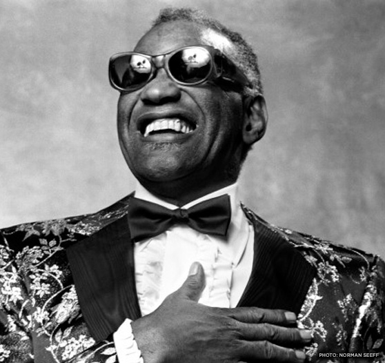 Ray Charles In A Floral Print Suit With A Bow Tie Sunglasses And A
