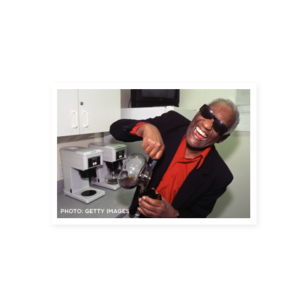 Ray Charles laughing and pouring a cup of coffee